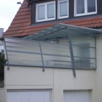 Terrassenüberdachung und Seitenwand mit Glasfüllung